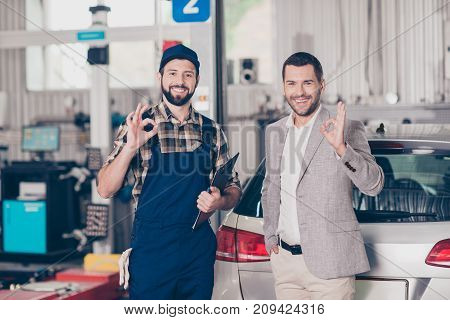 Two Attractive Guys, Specialist Repairman In Blue Overall, With Notes, Report, Businessman In Formal