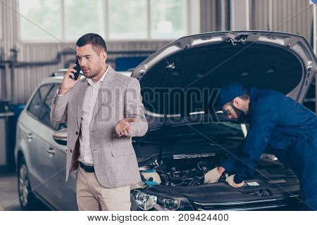 Attractive Serious Busy Owner Of A Car, Which Gets Appraising Of Damage By Bearded Expert Specialist