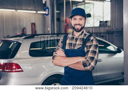 Attractive Successful Caucasian Car Expert At Work Shop Standing With Arms Crossed And Smiling At Ca