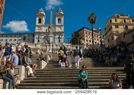 ROME, ITALY - OCTOBER 10, 2017: Tourists on Spanish steps in the main square of Rome
