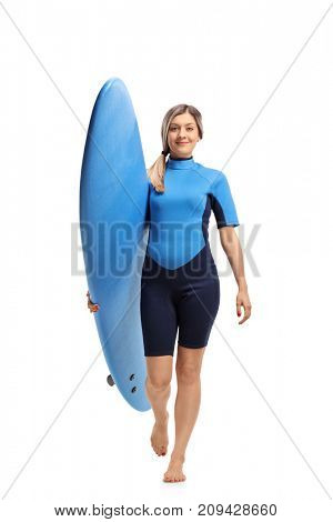 Full length portrait of a female surfer with a surfboard walking towards the camera isolated on white background