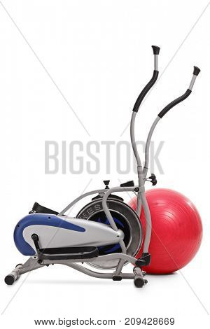 Cross trainer machine and a pilates ball isolated on white background