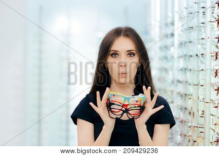 Funny Woman Trying Many Eyeglasses Frames in Optical Store
