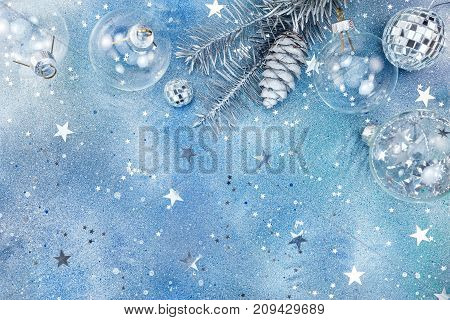 Silver Christmas Decorations On Glitter Background With Star Confetti