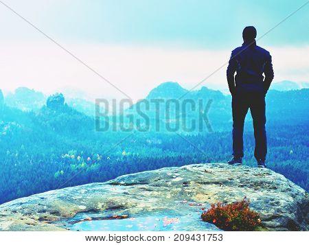 Hiker On Sharp Cliff  In Rock Park Watch Over Heavy Mist