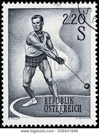 LUGA RUSSIA - AUGUST 20 2017: A stamp printed by AUSTRIA shows Hammer Thrower. Hammer throw is one of the four throwing events in regular track and field competitions circa 1967