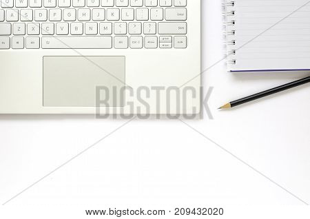 Laptop and note book and pencil on white background.
