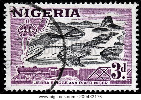 LUGA RUSSIA - OCTOBER 6 2017: A stamp printed by NIGERIA shows view of Niger river and Jebba bridge circa 1953