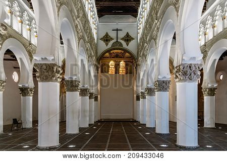 Toledo, Spain - October 13, 2017: Interior view of Santa Maria la Blanca Synagogue. It was constructed under the Christian Kingdom of Castile by Islamic architects.