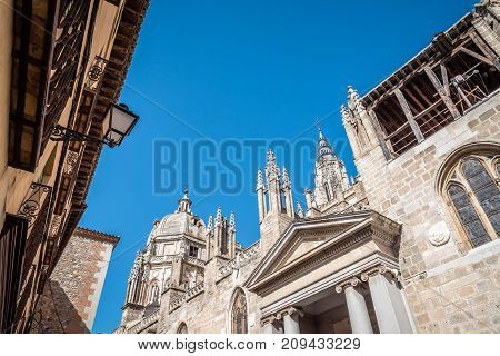 Toledo, Spain - October 13, 2017: Low angle outdoor view of the Cathedral of Toledo. The cathedral is one of the three 13th-century High Gothic cathedrals in Spain .