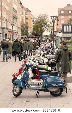 STOCKHOLM SWEDEN - SEPT 02 2017: Lots of parked vespa scooters and mods in the city at the Mods vs Rockers event at the Saint Eriks bridge Stockholm Sweden September 02 2017