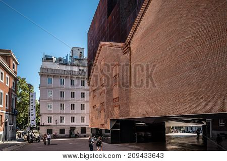 Madrid, Spain - October 14, 2017: Outdoors view of CaixaForum Madrid is a museum and cultural center in Paseo del Prado sponsored by La Caixa Bank. It was constructed by Herzog and de Meuron .