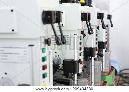 Benchtop vertical drilling machines. Black Lever Controls.
