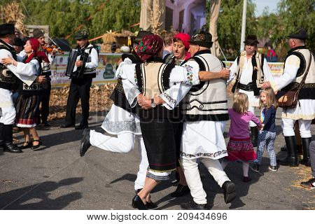 Romanian Folk Dancers Dancing In Traditional Costumes