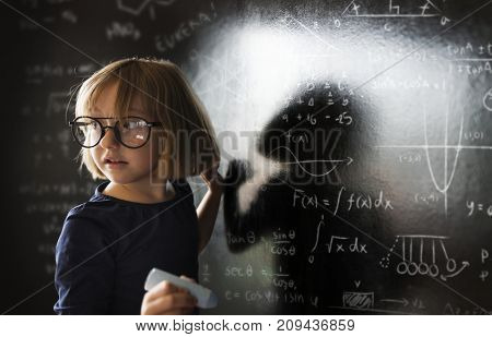 Little genius drawing up some science