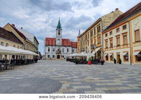 Churches and many casual cafes line the historic old city of Varazdin Croatia