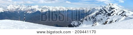 Snowy mountains with stop signs beautiful panorama view