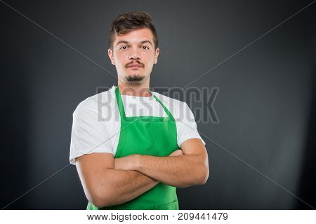 Portrait Of Attractive Male Supermarket Employer With Arms Crossed