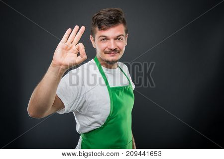 Portrait Of Attractive Supermarket Employer Showing Okay Gesture