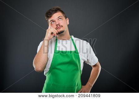 Portrait Of Attractive Supermarket Employer Posing Like Thinking