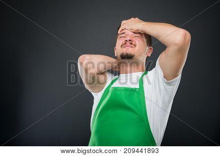 Supermarket Employer Holding Head Like Hurting