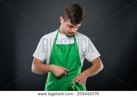 Portrait Supermarket Employer Looking In His Apron Pocket