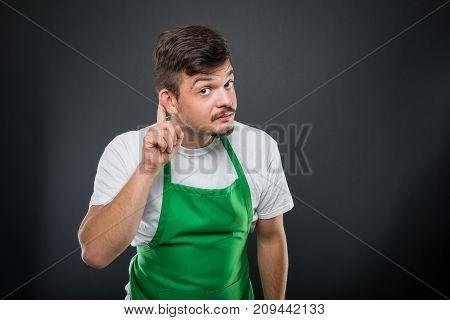 Supermarket Employer Posing Showing Not Hearing Gesture
