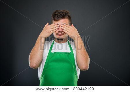 Portrait Of Supermarket Employer Gesturing Blind Monkey