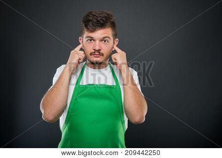 Portrait Of Supermarket Employer Gesturing Deaf Monkey