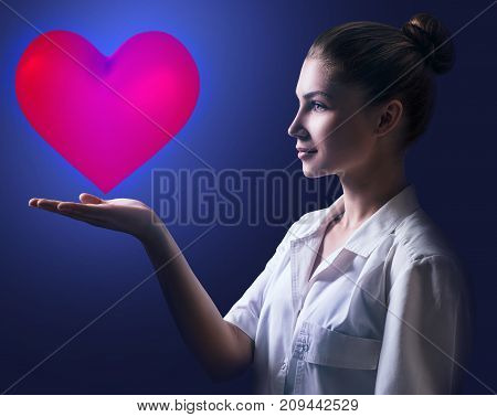 Cardiologist woman doctor holding big red heart. Healthcare concept.