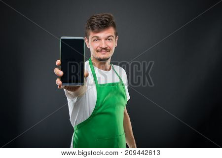 Portrait Supermarket Employer Showing Smartphone And Smiling