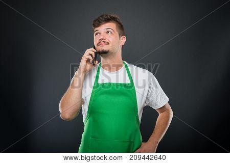 Portrait Supermarket Employer Talking At Telephone