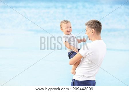 Father with little son on beach