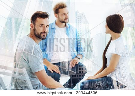 Mental health. Young bearded man looking satisfied while having psychological appointment