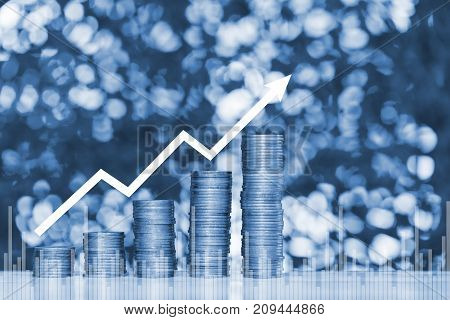 Double Exposure Of Stacks Of Coins On The Table In Garden With Financial Graph Chart, Finance And Bu