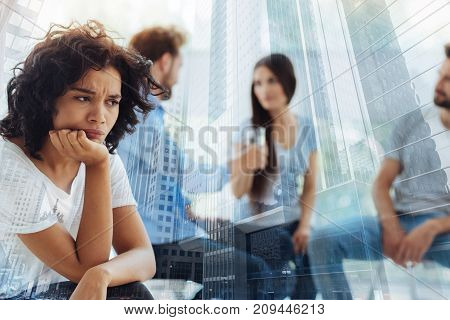 Why me. Close up of nervous woman being unsatisfied while having psychological appointment with her friends