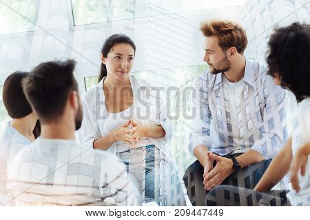 Warm talk. Best friends having discussion with psychologist while sitting together and expressing interest