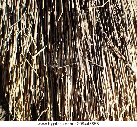 Close-up image of part of besom, textured background.