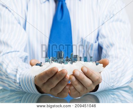 Businessman sitting at table presenting real estate insurance concept