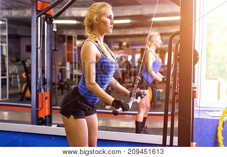 Sports Woman Doing The Exercise For Chest At The Crossover Machine In The Gym.