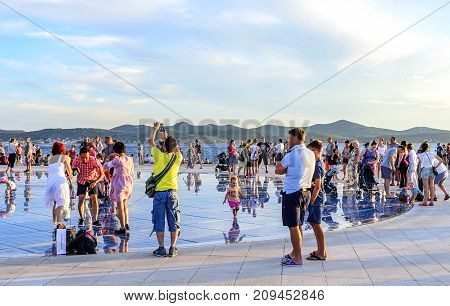ZADAR, CROATIA - 15 JULY, 2017: Greeting Sun Zadar Croatia People at sunset
