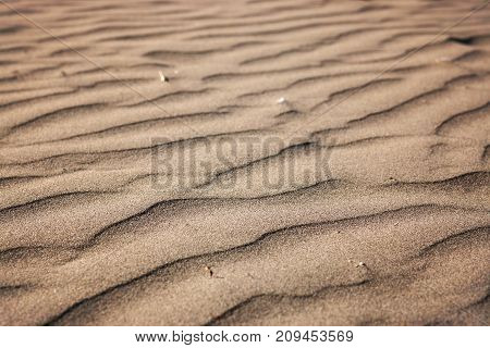 Sand On The Beach In The Form Of Waves