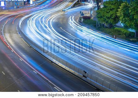 rush-hour traffic trails in downtown hong kong,china,asia.