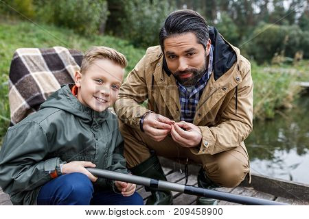 Father And Son Fishing With Rod