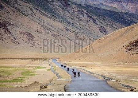 Motorcyclists on the road through Changthang plateau in Ladakh region of Kashmir, India