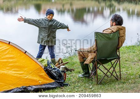 Father And Son In Camping At Lake