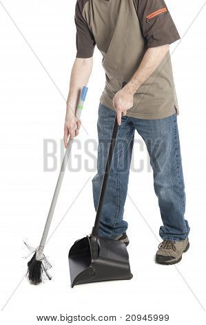 Man Sweeping Dirt Into A Dustpan