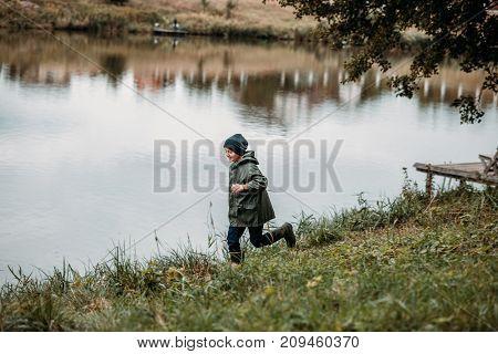 Boy Running At Lake