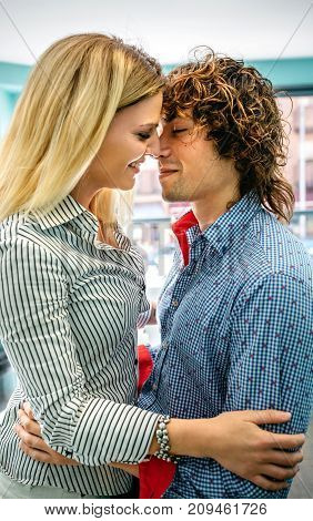 Man and woman about to kiss in a coffee shop