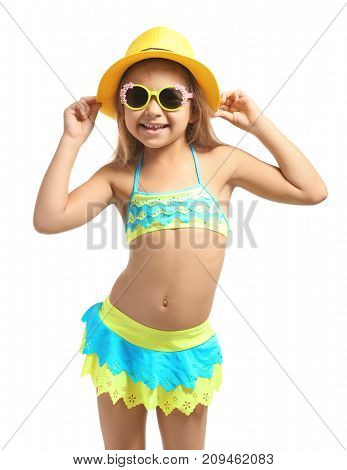 Adorable little girl in swimsuit and hat on white background
